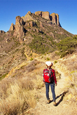 Hiker on the Lost Mine Trail, Casa Grande Rock Formation, Chisos Mountains, Chihuahuan Desert, Big Bend National Park, Texas