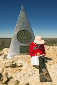 Hiker at Summit Memorial with Hiker Register, Guadalupe Peak Trail, Guadalupe Mountains National Park, Chihuahuan Desert, Texas