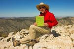 Hiker at Summit with Hiker Register, Guadalupe Peak Trail, Guadalupe Mountains National Park, Chihuahuan Desert, Texas