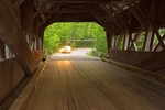 Car Driving Through Albany Covered Bridge Over the Swift River, 19th Century Historic Bridge, Kancamagus Highway, White Mountains, New Hampshire