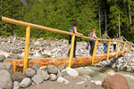 Hikers on the Wooden Footbridge Over The Nisqually River, Carter Falls Trail, Wonderland Trail, Mount Rainier National Park, Washington