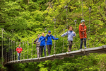 Hikers on Suspension Bridge Over the Ohanapecosh River, Grove of the Patriarchs, Mount Rainier National Park, Washington