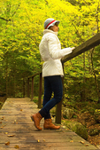 Hiker on Wooden Footbridge Over Coppermine Brook, White Mountains, Franconia, New Hampshire