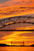 Cape Cod Canal Railroad Bridge Framed in the Bourne Bridge at Sunset, Cape Cod Canal, Arch Bridge with Suspended Deck, Bourne, Massachusetts