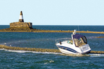 Boat on the Rocks at Nix's Mate Daybeacon, Nixes Mate, Day Marker Aid to Navigation, Boston Harbor Islands National Recreation Area, Massachusetts