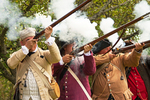 American Revolutionary Colonial Soldier Reenactors Firing Muskets