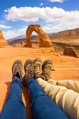 Hiker's Feet at Delicate Arch, Arches National Park, Colorado Plateau, Moab, Utah