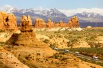 Recreational Vehicles Driving Through the Garden Of Eden, La Sal Mountains, Erosional Pinnacles and Cliffs, Arches National Park, Colorado Plateau, Moab, Utah