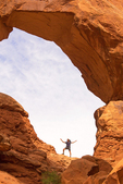 Hiker at Double Arch, Arches National Park, Colorado Plateau, Moab, Utah