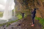 People in Cave Behind Seljalandsfoss Waterfall, Seljalands River, Iceland