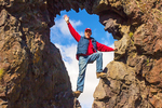 Person in Lava Rock Arch on Djupalonssandur Beach, Snaefellsjokull National Park, Snaefellsnes Peninsula, Iceland