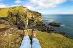 Hiker's Feet and Pufubjarg Cliffs, Snaefellsjokull National Park, Snaefellsnes Peninsula, Iceland,