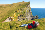 Hiker Relaxing on Latrabjarg Cliffs, Westfjords, Iceland