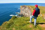 Hiker on Latrabjarg Cliffs, Westfjords, Iceland