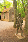 Henry David Thoreau House Replica and Thoreau Statue, Log Cabin in Woods, Walden Pond, Concord, Massachusetts