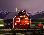 Spotlight on barn at sunset