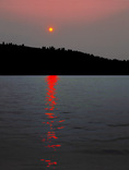 Fire in the woods, smoky sunset from Wallowa Lake