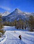 Snow boarders at Anthony Lake ski area below Gunsight Peak