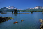 Canoes on Sparks Lake beneath the South Sister and Broken Top Mountain