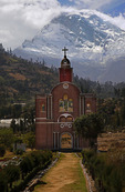 Replica facade of destroyed Yungay cathedral below Nevado Huascaran Norte