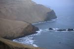 Pan American Highway traversing dunes above Pacific Ocean