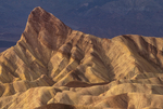 739650016 colored sandstone formations at zabriski point with manly beacon prominent in the scene in death valley national park california. Extensive coverage of numerous North American parks and other geographic locations.