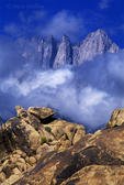 711700052 low clouds frame mount whitney and the sierras during a clearing summer storm in the alabama hills blm lands in the eastern sierras near lone pine california. Extensive coverage of numerous North American parks and other geographic locations.