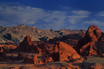 792980018 low angled sunset light highlights the sandstone formations and red rock mountains giving a three dimensional effect to the scene in valley of fire state park nevada. Extensive coverage of numerous North American parks and other geographic locations.