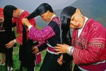 Red Yao women combing hair at Longji's Huanglo Yao village (Guilin area)