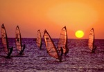 Israeli windsurfers with Mediterrean sunset