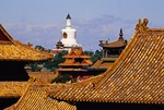 Forbidden City (Imperial Palace Museum) rooftops and White Dagoda in nearby Bai Hai Park