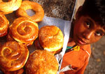 Sanliurfa (Urfa) boy selling breads in outdoor cafe of old bazaar