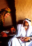 Kurdish woman serving tea to Arab man