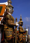 Bangkok's demon Yaksha statues guarding Wat Pra Keo at the Grand Palace