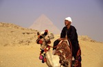 Egyptian man on camel at Great Pyramids