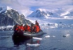 Antarctic zodiac with tourists from cruise ship on Antarctic peninsula