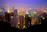 Hong Kong skyline at night from Victoria Peak with harbor and Kowloon peninsula in background