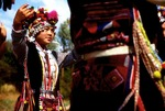 Aini minority nationality dancers in ceremonial dress