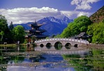 Black Dragon Pool's Moon-Embracing Pavilion and Belt Bridge with Jade Dragon Snow Mountain in background