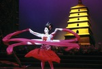 Tang dynasty ribbon dance from The Silk Road performed by Shaanxi Provincial Song & Dance Troupe, dancer with Dayan (Big Wild Goose) pagoda backdrop