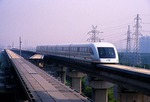 Shanghai Maglev train on track through Pudong