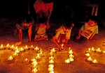 Yangon's Shwedagon Pagoda with children lighting candles for religious observance