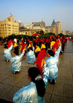 Shanghai's Bund with women's morning exercise team holding fans