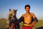 Mongolian horseman at Naadam Festival in summer on the grassland near Hohhot