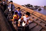 Suzhou Grand Canal bridge with bicyclist pedestrians