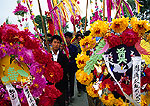 Chinese funeral wreaths being carried by mourners for funeral of a local party official