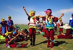 Mongolian children dancing at Nadaam Festival on the grassland near Hohhot