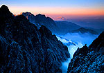 Huangshan's Grand Canyon in winter at dawn viewed from Cloud Dispelling Pavilion