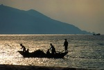 Hainan island fishermen offshore in boat on the South China Sea