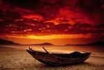 Hainan Island fishing boat on beach at dawn at Yalong Bay of South China Sea